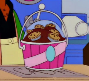 Bucket-of-ice-cream-covered-with-miniature-pies-FI